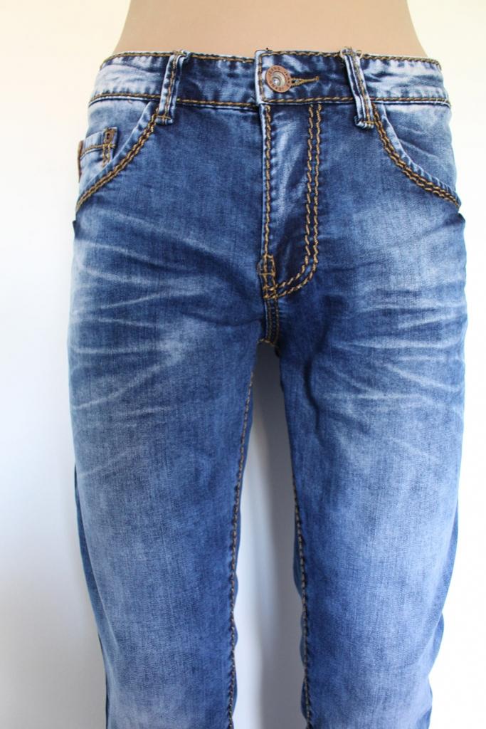 Spodnie jeansowe jasne wycierane szyte grubą nicią